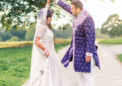 asian groom in sherwani with bride in lehnga
